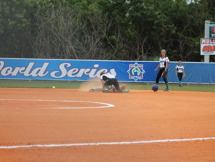 Madison's Ashley Hamlin slides safely into second base.