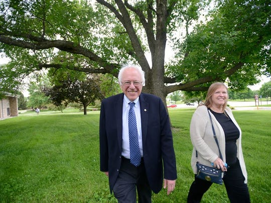 Bernie and Jane Sanders arrive at Muscatine Community
