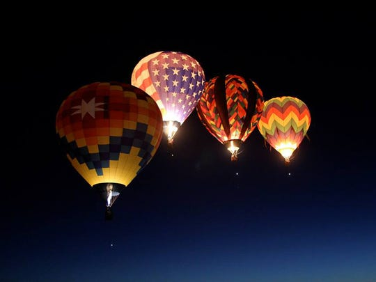 The Sonoma Star balloon (left) during the mass ascension during the 2014 Great Reno Balloon Race. The balloon sports a Nevada Humane Society banner during this year's event.