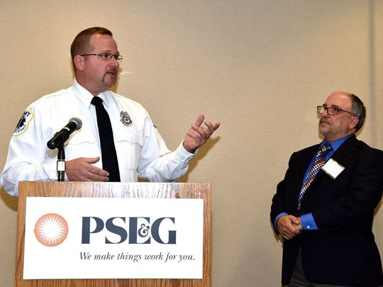 Jerry Pandolfo, chief of the Atlantic Highlands First Aid & Safety Squad, accepts a top volunteerism award from PSE&G earlier this month.