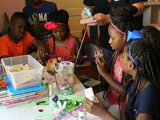 Students learn art skills at Renzi Education and Art Center summer camp.