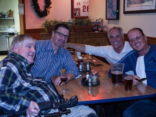 Joe Campbell (far right) gathers with former Salesianum football teammates (L-R) Dennis Kelly, Tom Needles and Bob LaFazia in November at Grotto's Pizza in Wilmington.