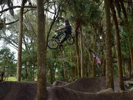 Mark Mulville launches his BMX bike high above the