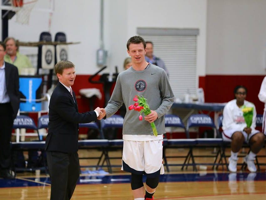 Carolina Day's Spencer Kirkpatrick shakes hands with coach Trip Cogburn during the Wildcats' Senior Night ceremony on Jan. 29. Kirkpatrick has committed to play college basketball for North Greenville (S.C.).