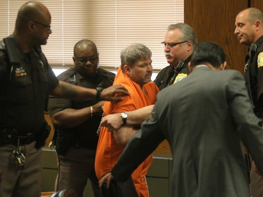 Jason Dalton is forcibly removed from the courtroom