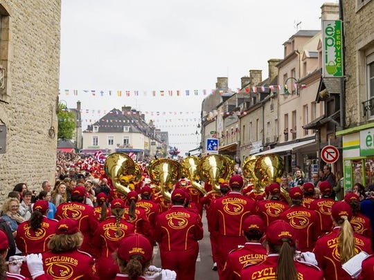 The Iowa State marching band performing in a memorial