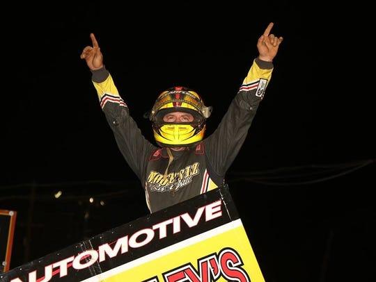 Brock Zearfoss celebrates his 410 Sprint victory at