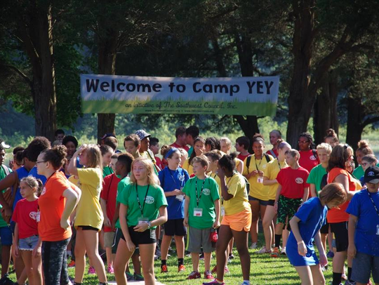 Participants in Camp YEY compete in color wars.