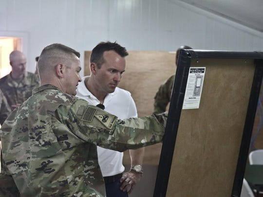 Col. Lee Magee, left, commander of 3rd Brigade, briefs Secretary of the Army Eric K. Fanning on the brigade's partnership engagements and exchanges.