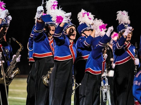 The Madison High School Patriot Marching Band cheers