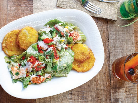 The South of Bar Harbor greens, with lobster and fried green tomatoes, balanced creamy and citrusy flavors.