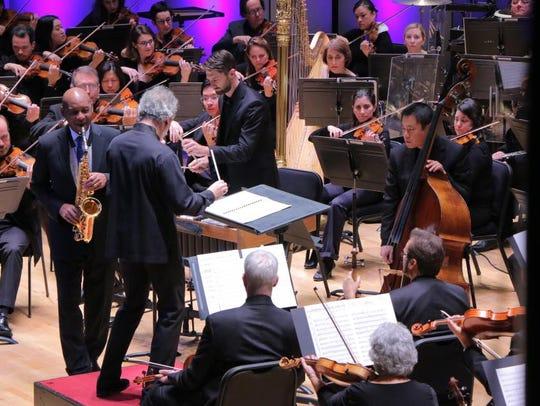 Branford Marsalis performs on alto saxophone with Louis