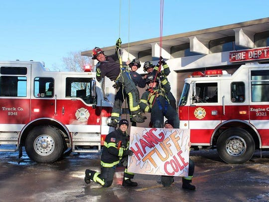 Firefighters from Appleton wish Cole Ewerdt well.