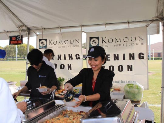 Food vendors serve food during 2016 AsiaFest.