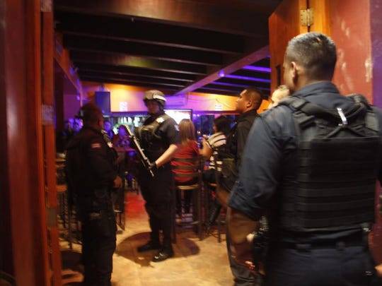 Juárez police search bars during a recent crime-prevention operation.