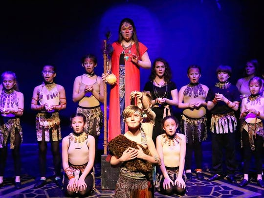 Colin Kramer as Young Simba and Rafiki played by Ava Bartley with the Lionesses.