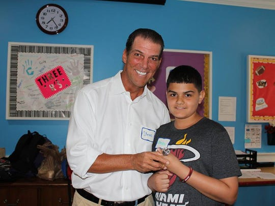 Baltimore Ravens owner Steve Bisciotti meets with a