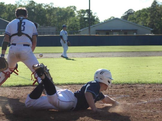 Lakeside's Logan McIver slides safely home during a game this season.