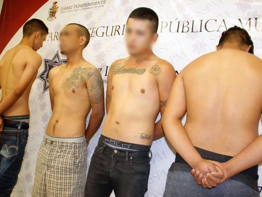 Juárez police arrested four alleged members of a Mexicles gang hit squad in 2017. File art.