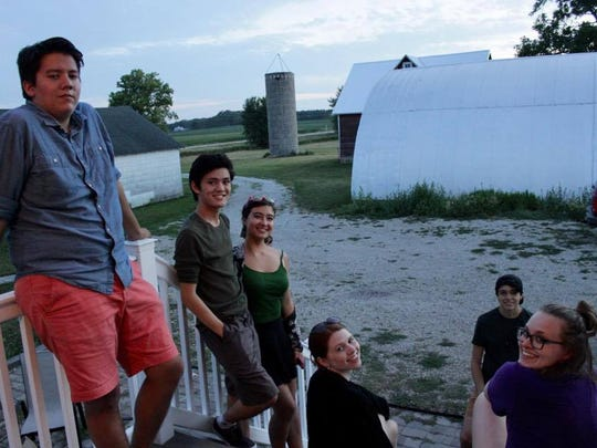 A few of the college students who moved to Iowa to perform for the Cedar Summerstock Theater in St. Ansgar relax on a farm between long practices and performances.
