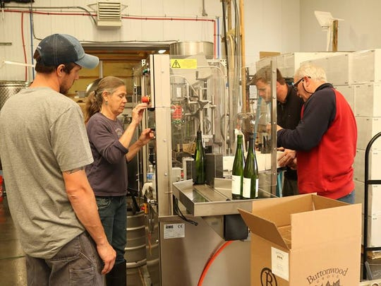 The staff at Buttonwood Grove Winery bottle a Melody Block Riesling.