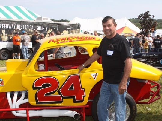 Driver Stan Ploski Jr. stands alongside the Joe Baumann owned No. 24 replica car that he drove for Ken Brenn Sr.