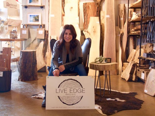 Live Edge Detroit cofounder Jennifer Barger takes a break at The Rust Belt Market in Ferndale where the company's repurposed wood is sold in DIY table, bench and shelf kits.