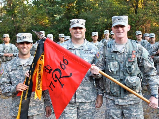 Shiloh Butterworth, flanked by Army ROTC Cadets Joseph Brennan and Drew Kennedy in 2013, served as a military instructor at Rutgers and earned a labor degree from the School of Management and Labor Relations.
