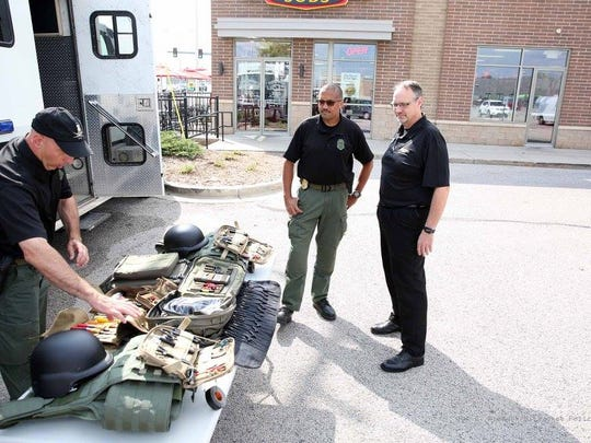 Milwaukee police officers check out equipment donated by Firehouse Subs.