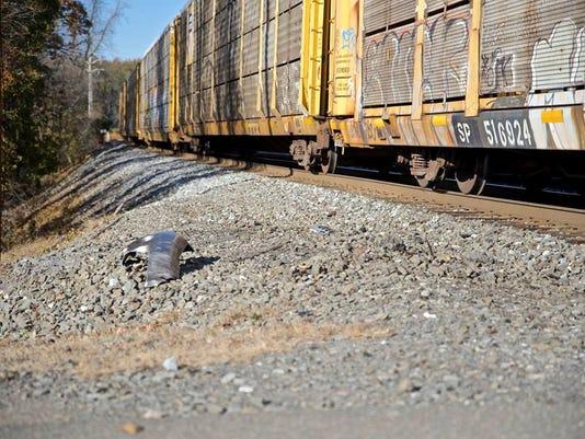 CSX train clips SUV