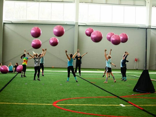 The Plymouth-Canton Marching Band color guard gets in some practice before the grand nationals in Indianapolis.