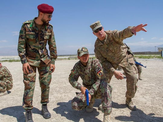 Soldiers from 1st Battalion, 36th Infantry Regiment train Afghan army soldiers on tactical formation movements, bounding and fighting through an ambush in order to hone their squad and team tactical skills.