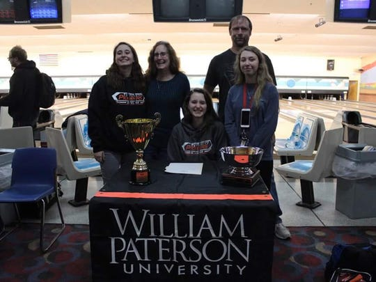 Delone Catholic's Amanda Barna, center, signed a letter of intent on Feb. 10 to continue her bowling career at William Patterson University.