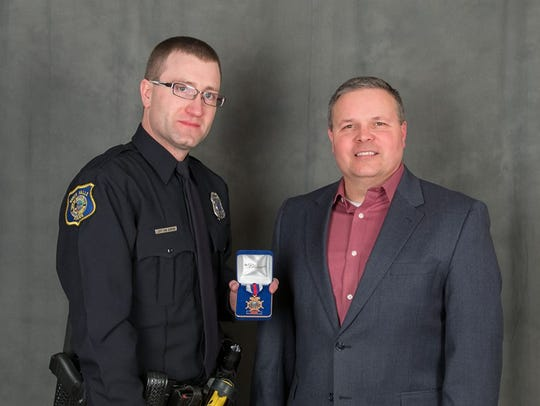 Officer Jeff Van Gerpen is awarded the Sioux Falls