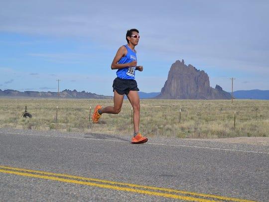 Ki-jana Martinez runs the half-marathon course near the Shiprock pinnacle on May 7, 2016.