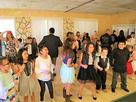 Children of all ages showed up in their best to dance
