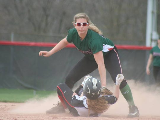 Lawrence North's Taylor Erschen applies the tag.