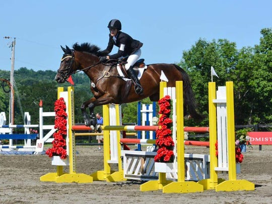 Hannah Daneker and her horse, Parris, in the first part of dressage competition.