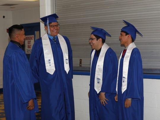 Bloomfield High School graduates Christian King, left,