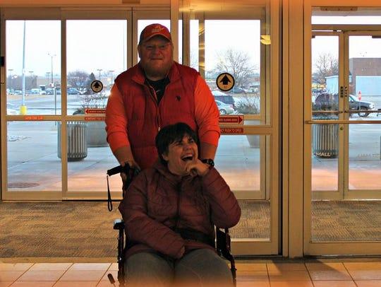 Pictured are Coach Brian Shaver and participant Victoria