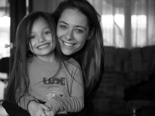 Alex Robertson, 24, shown with her daughter Madilyn Mills, died last June in a crash in Delhi Township. Now her family has created a foundation to offer financial assistance to families who face the sudden loss of a loved one.