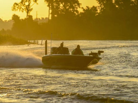 An angler shoots across the Red River during Friday's second day of the Bass Pro Shops Central Open.
