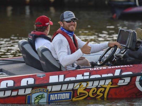Pro angler Caleb Sumrall heads out on the Red River Friday morning.