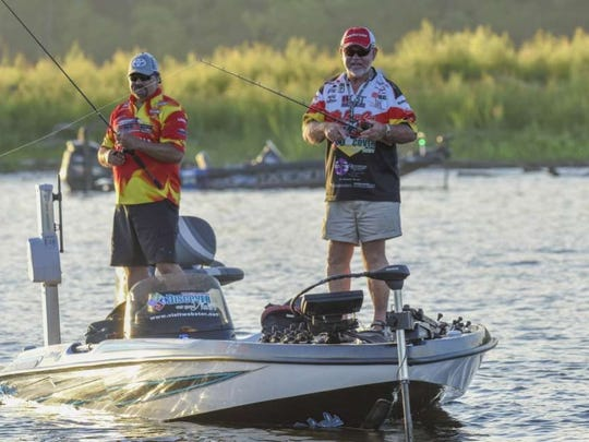 Minden pro Homer Humphreys (right) works for fish on day 2 of the 2018 Bass Pro Shops Central Open on the Red River.