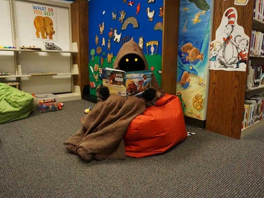This Jawa, DZ-25752, was at a Waupun Public Library