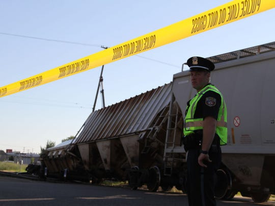 Police say approximately 15 train cars have derailed