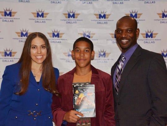 Malachi (middle) celebrates his e-book release on June