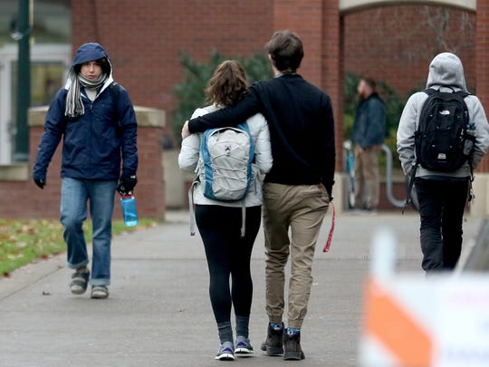 People walk in the near-freezing temperatures at Willamette