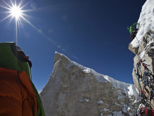 Conrad Anker looks up at Jimmy Chin as they continue