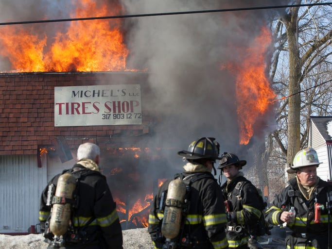 By noon Feb. 19, 2014, Indianapolis Fire Department crews had under control a large fire at Michel's Tire Shop near 30th Street and Lafayette Road.